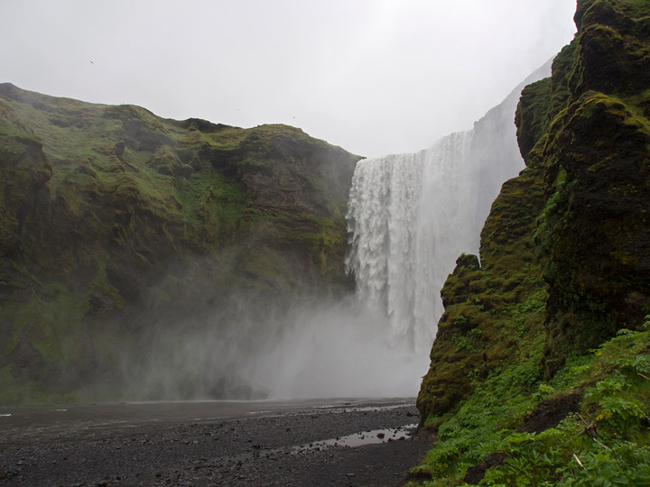 large waterfall at skaftafell park in iceland